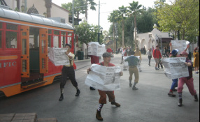 The Newsies hop off the Red Car Trolley to sell their papers