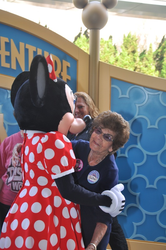 Minnie Mouse hugging Grahms